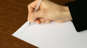 stock-footage-busy-man-writing-a-formal-letter-to-manager-hands-close-up